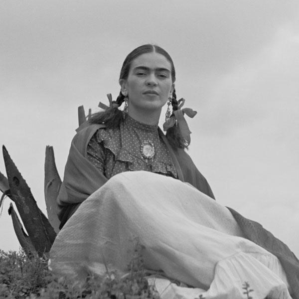 Frida Kahlo sits atop a hill