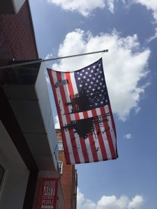 American flag with artist design over top