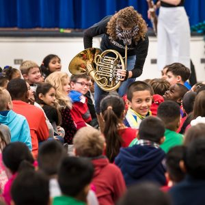 french horn player with students